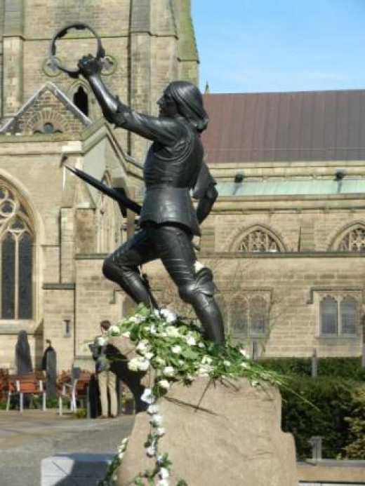 The statue of King Richard III stands outside Leicester Cathedral and on the morning after the reinterment is strewn with white roses representing the House of York.