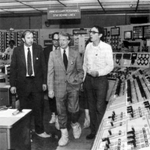 President Cater walking through the control room at Three Mile Island soon after the meltdown of the core of its reactor.
