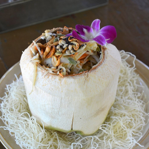 Delightful dish served in a whole coconut with shell removed