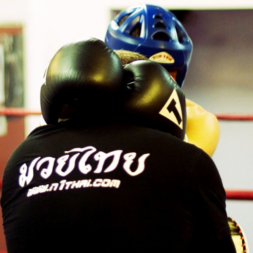 "The ""pat and crash"" entry is an effective means of establishing a necktie clinch in Muay Thai or MMA."