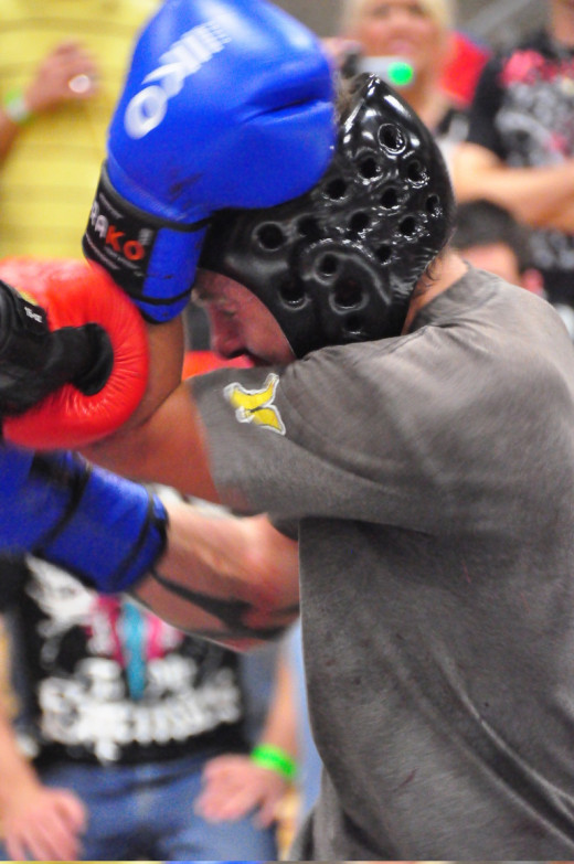 A high, tight guard is essential in the close range from which you can effectively throw elbows in Muay Thai and MMA.