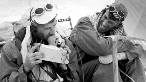 Sir Edmund Hillary and friend enjoy a laugh about the technical aspect of such a climb as they have just accomplished