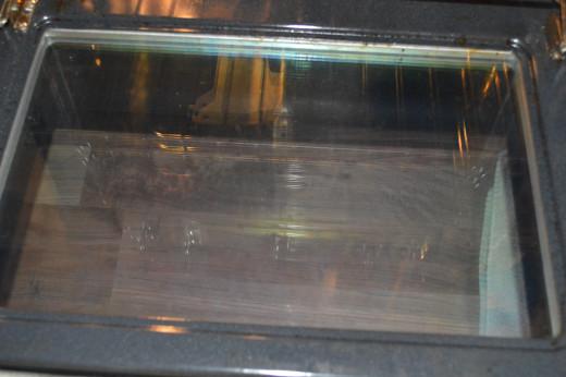 Fumeless oven cleaner