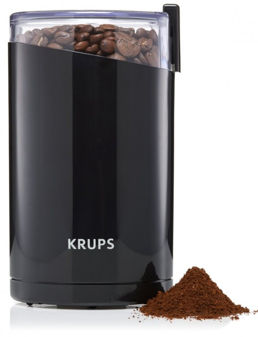 KRUPS F203 Electric blade grinder.  Blade grinders are usually relatively affordable compared to burr grinders, but they tend to be noisier, and less precise. The grinding process involves a spinning blade which chops the beans up.