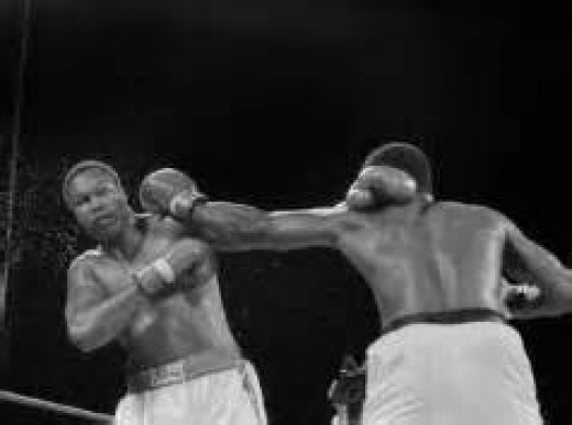 Larry Holmes (left) fought Michael Spinks twice and lost both times.