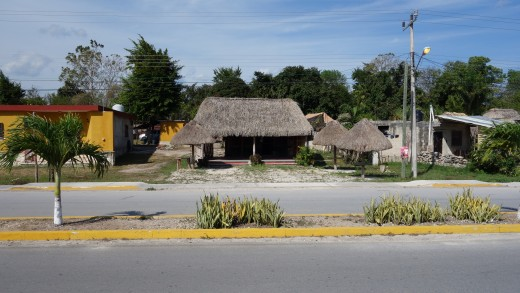 The old restaurant that we've had our first meal in Coba twenty years ago.  It is no longer a restaurant, but the hut and the tables and chairs are still there.  Photo taken March 2015.  The road is much wider now than it was years ago.