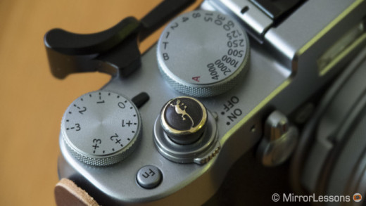 The Lensmate soft release (brass lizard version) attached to the Fujifilm X100T