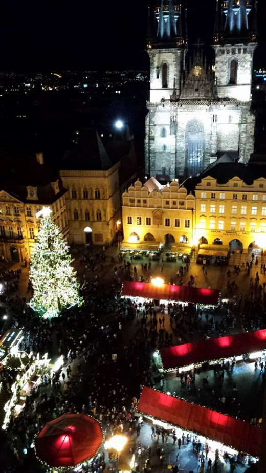 The Christmas Eve view from atop Prague's Clock Tower, with the 1385 Tyn Church standing sentinel above the nightlife: one of the world's grandest urban spectacles.