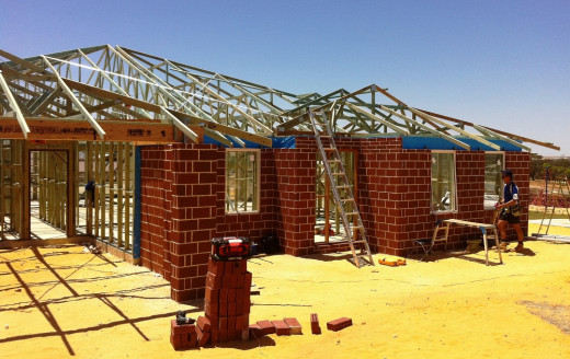 House reaching roof framing completed.