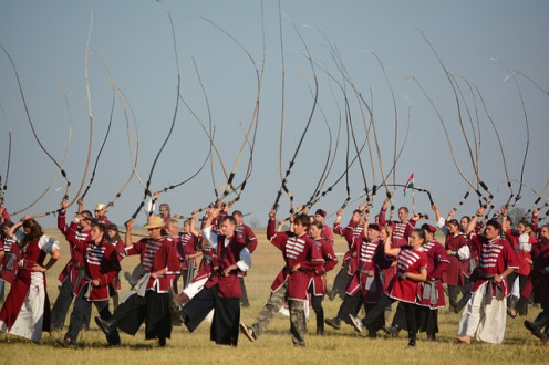 In a Hungarian traditional whip celebration, men and women perform a synchronized whip display. Hungarian pig farmers used whips to drive large groups of large woolly pigs with the cracking noise.