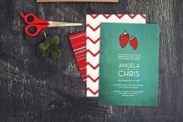 A bright red strawberry pops in a chalkboard green background