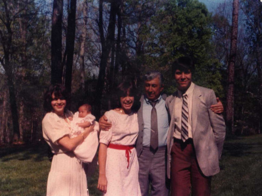 Easter, 1982. My grandfather with me, my sister, aunt and cousin, doing something out-of-character for his generation.