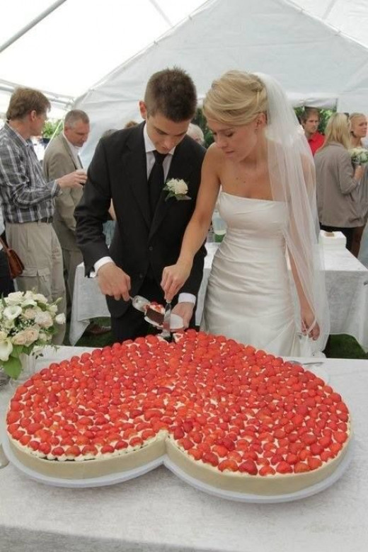 Have a big hear-shaped wedding cake. Why not? And since strawberries are heart-shaped too, go all out and top it with lots and lots of strawberries.
