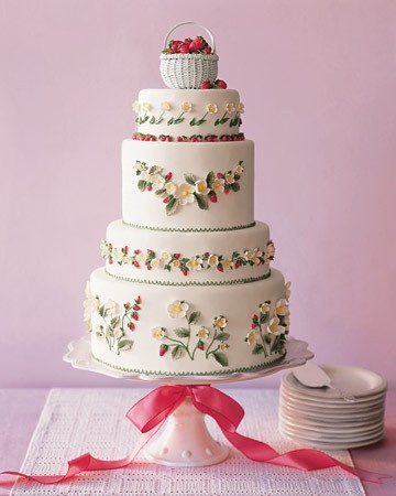 Decorate your wedding cake with a sweet floral and strawberry design, and topped it with a basket of fresh strawberries