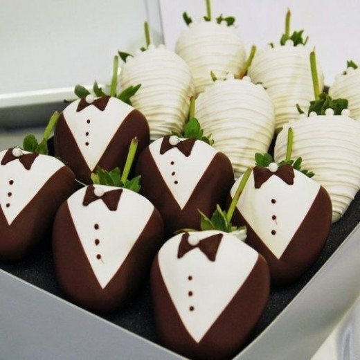No strawberry wedding theme can be without these chocolate-coated strawberries in white lace and tuxedo