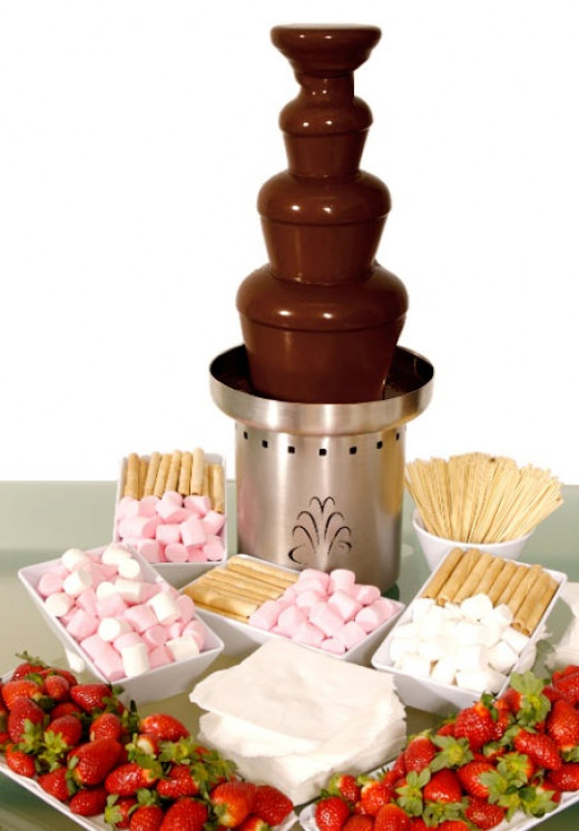 Chocolate fondue with strawberries and marshmallows.
