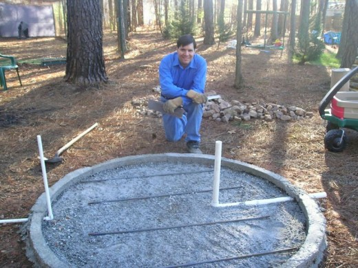 I used steel reinforcing bars to keep the foundation from cracking at it settled. The inner part of the circle was filled with the contents of several dry 60-pound bags of Quikrete, then water was added to start the concrete's curing in water.