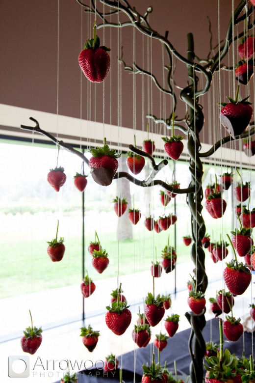 Hanging chocolate-dipped strawberries