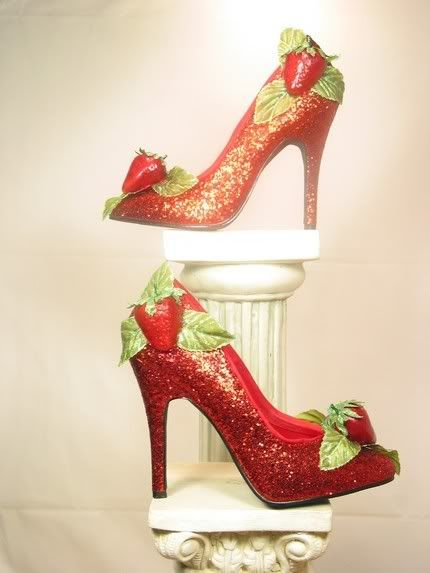 Glittery red pumps with strawberry decors.