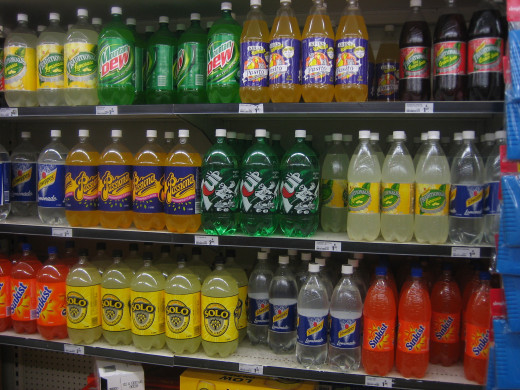 A shelf full of sodas in the grocery store
