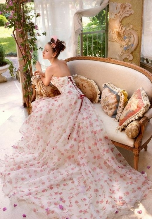 If you're brave and you think you can pull it off, have strawberries all over your wedding gown. (Well, this one isn't exactly strawberry prints, but it can be - just replace the floral with strawberries).