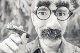 Non-churchgoer with fake funny mustache