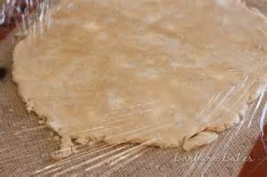 roll pie dough between plastic wrap