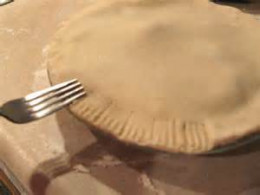 Using a fork on pie dough.