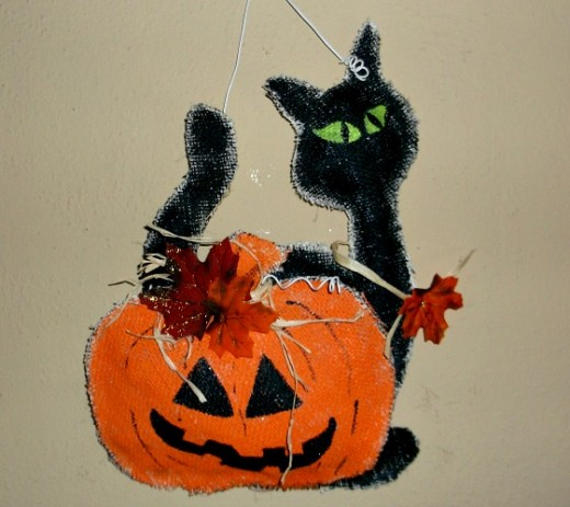 black cat and pumpkin burlap door hanger