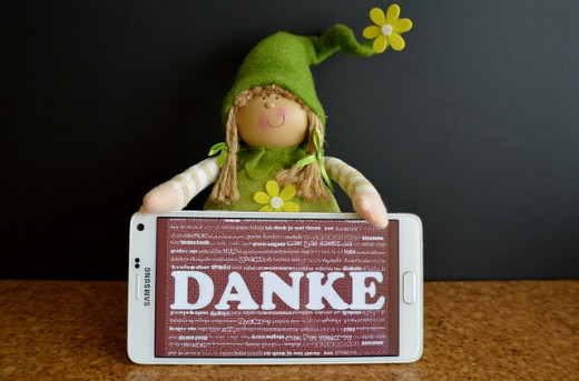 thank you with a danke and a little blond doll in a green cap