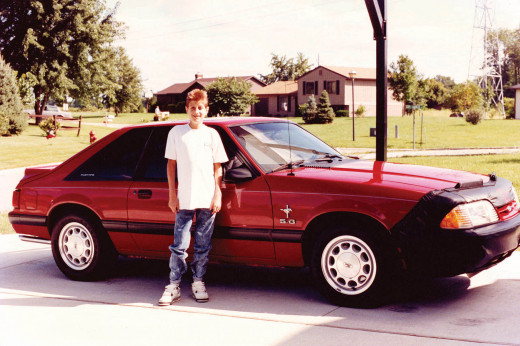 Ryan White, a Hoosier, poses with the red Ford Mustang that pop superstar Michael Jackson bought for him.