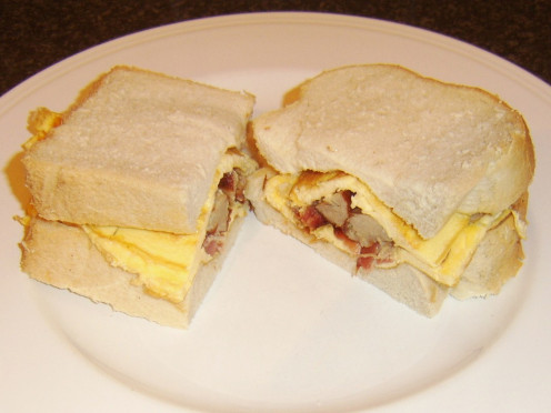 Cooked and chopped bacon and sausage are incorporated in a simple duck egg omelette for this sandwich