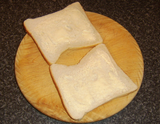 Butter is optional on the bread for the sandwich