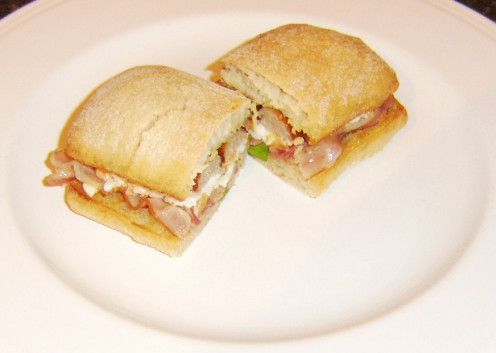 Italian pancetta, egg and sausage on a ciabatta bread sandwich