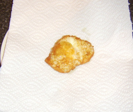Deep fried egg is drained