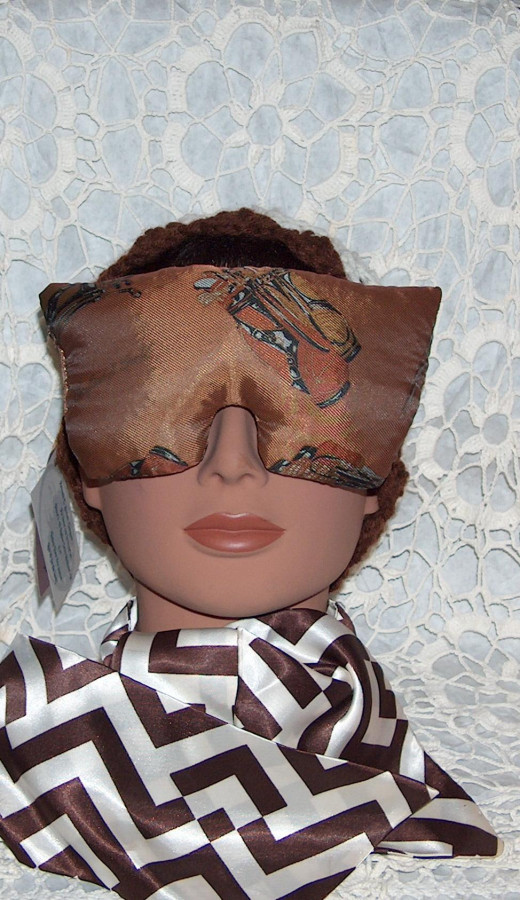 A hand sewn eye mask with lavender flowers inside made from vintage fabric.