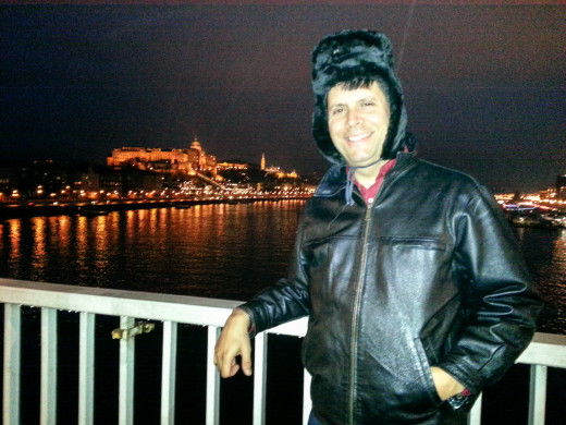 "I admire the Buda Castle from a Danube River Bridge. I later lost the hat, which a friend had described as ""horrid""."