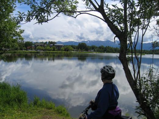 Jeanne overlooking Mt. McKinley in Alaska on her bike