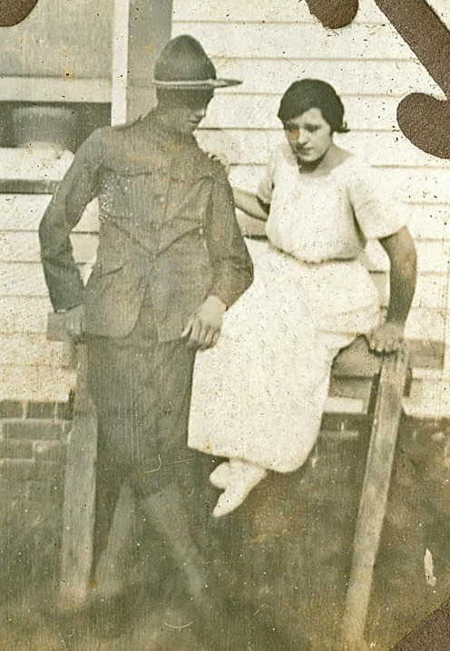 My grandmother Ruth is wearing white slippers in this photo. Her new husband, Clarence McGhee is heading off to France for WWI.