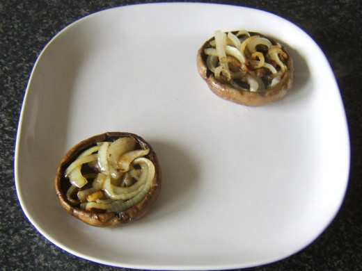 Fried mushrooms and onions are plated