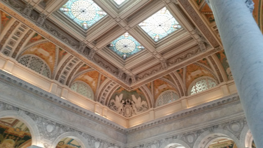 There are paintings and different genres of books all along the ceiling, along with quotes and names of famous authors!