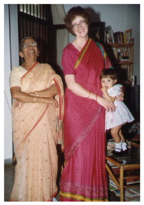 My sister lived in India for over 10 years. You'll notice that her daughter is wearing a child's dress, not a sari. My sister is wearing the rose colored sari and looks very elegant.