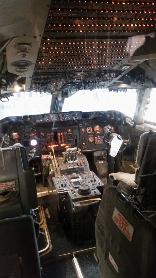 The inside of a cockpit of a typical airplane that you might use to go on vacation!