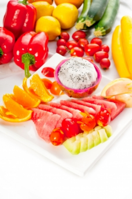 Mixed Plate Of Fresh Sliced Fruits Stock Photo