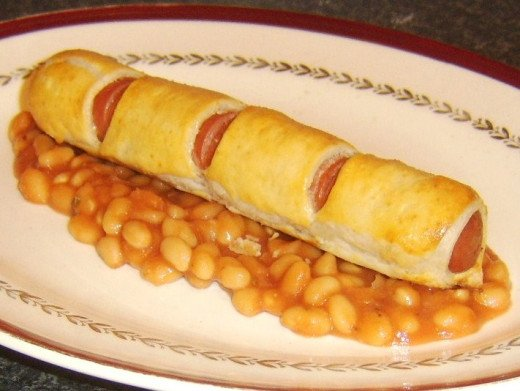 Sausage roll dog with baked beans in tomato sauce