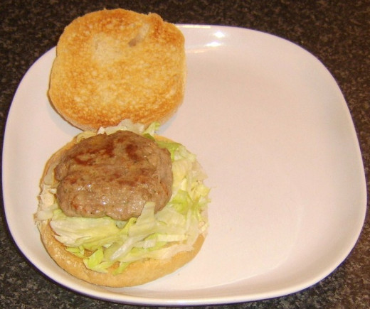 Lamb burger is laid on iceberg lettuce bed
