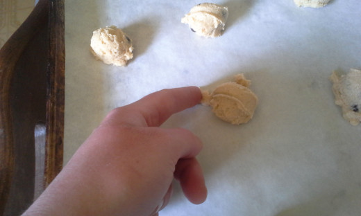 Smooth any rough edges of dough before baking to get more uniform cookies.