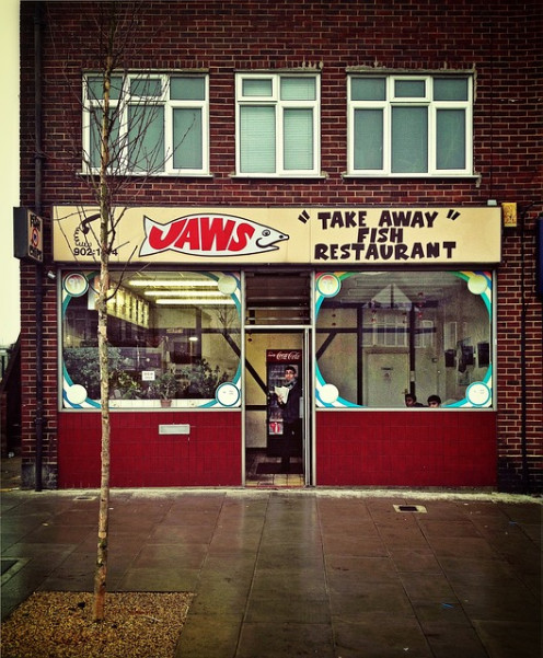"""Jaws"" - a fast food takeaway and the expenses that eat away both 1) workers' paychecks and 2) employer's profits."