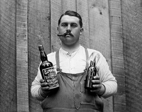 A man in 1900 drinks both beer and whiskey.
