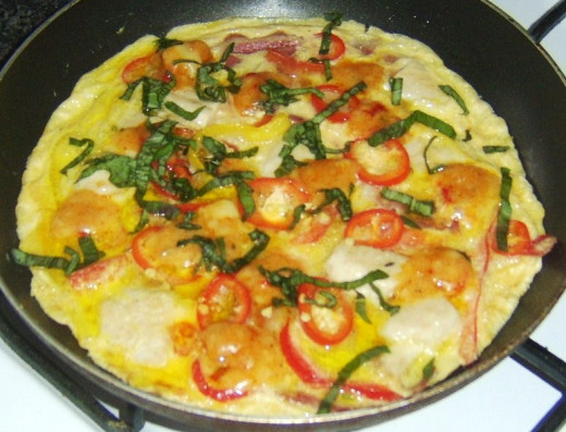 Spicy chicken and bacon frittata is garnished and ready to serve